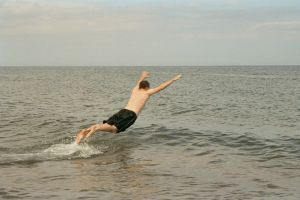 Swimmer doing a belly flop